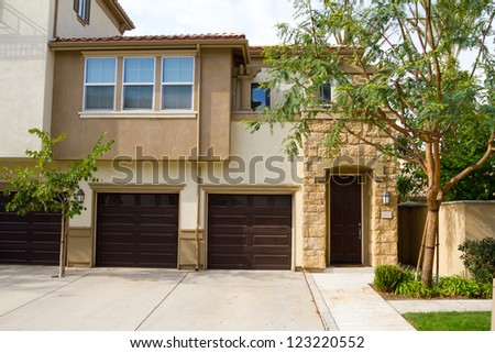 A condo in Southern California has doors that open to a courtyard type entryway. - stock photo