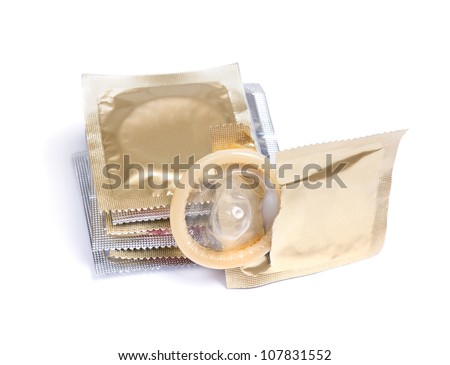 A condom with it's package isolated on white background - stock photo