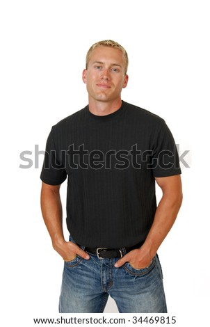 A confident blond man with his hands in his pockets - stock photo