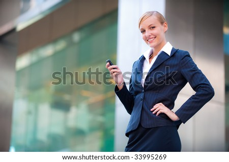 A confident businesswoman on the phone in the city