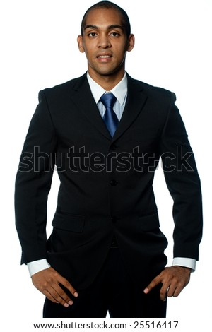 A confident smiling young black businessman on white background - stock photo