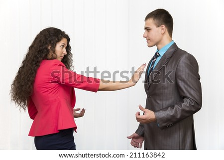 A conflict between male and female corporate workers - stock photo