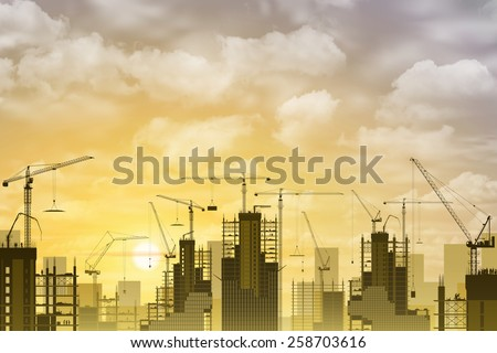 A Construction Site with Lots of Tower Cranes with Sunset, Sunrise. - stock photo