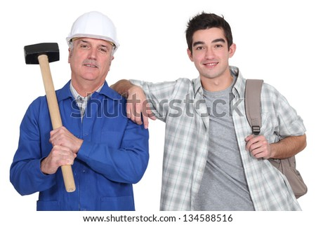 A construction worker and his trainee. - stock photo