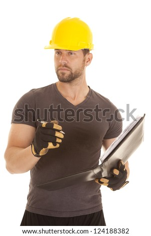 A construction worker holding onto his binder and pen with a serious expression on his face. - stock photo