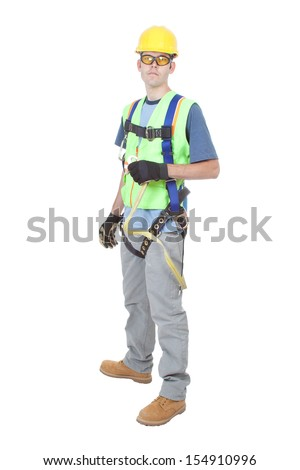 A construction worker wearing a safety climbing harness and other safety gear and isolated on white.