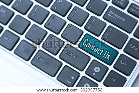 A 'contact us' message on keyboard, internet or online contact through website. - stock photo