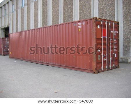 A container in front of warehouse - stock photo