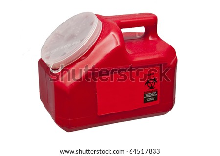 A container used to store used needles for medical purposes - stock photo