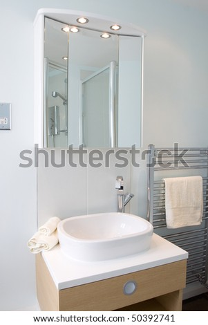 A contemporary designer bathroom in a new property development - stock photo