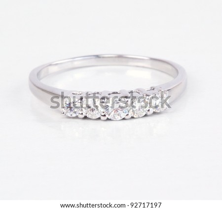 A contemporary diamond ring. Row of 5 diamonds. - stock photo