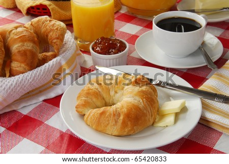 A continental breakfast served on a picnic table - stock photo