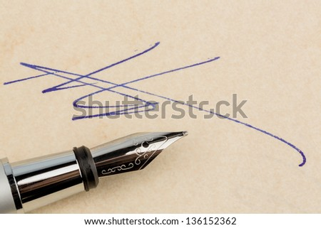 a contract or document is signed by hand with a fountain pen. - stock photo
