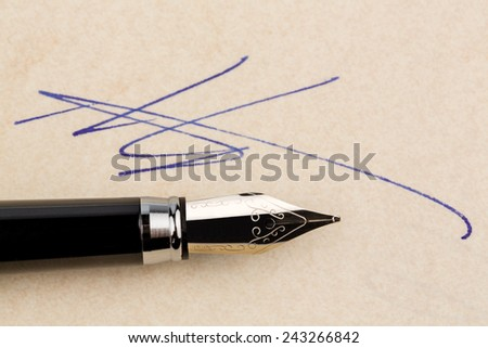a contract or document shall be signed by hand with a fountain pen. - stock photo