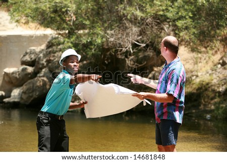 a contractor and client argue about where the locations of a project should be - stock photo