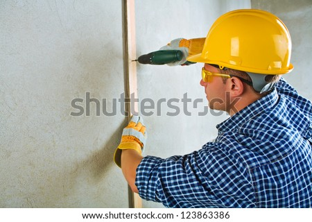 a contractor working with electrical screwdriwer