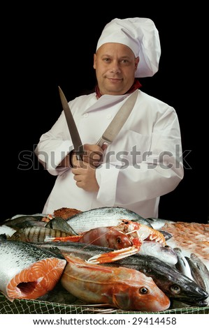 a cook or chef preparing the fish or a fish dealer - stock photo