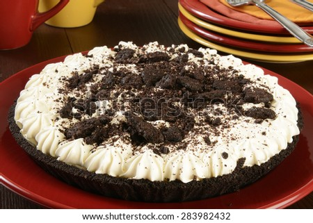 A cookies and cream pie with serving plates - stock photo