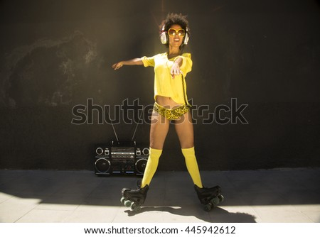 a cool roller skating woman dances and skates outside in an urban setting - stock photo
