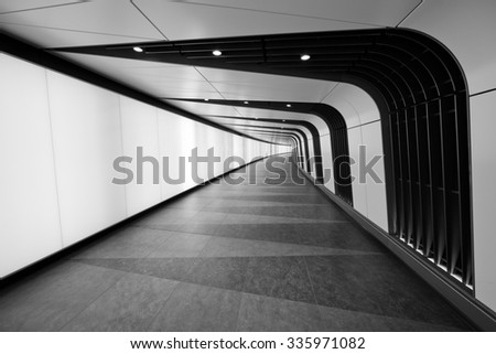 A cool underground path of Kings Cross train station, London, UK. - stock photo