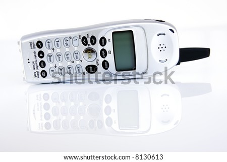 A cordless home phone isolated on a white background.