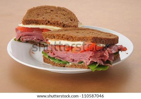 a corned beef sandwich on rye bread - stock photo