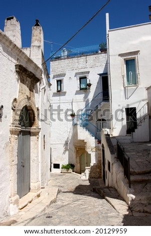 A corner in Ostuni, a whitewashed village in Apulia, Italy