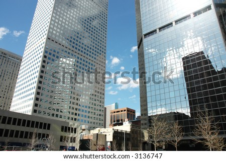 a corporate skyscraper against the blue sky