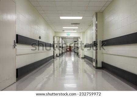 A corridor in a nice, modern hospital. - stock photo
