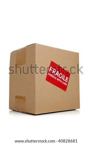 a corrugated cardboard moving box with a fragile sticker on a white background - stock photo