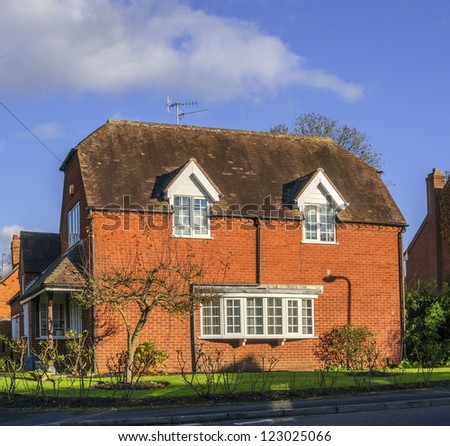 a cottage in an english village - stock photo