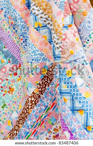 A cotton patchwork quilt, in fresh, bright colors - stock photo