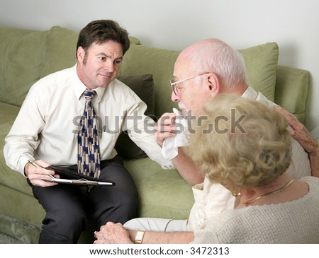 A counselor helping a grieving couple.  The husband is crying. - stock photo