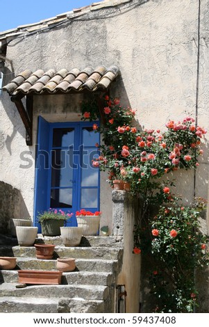 A country house in a village in France with a blue door