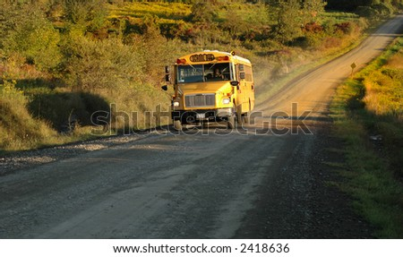 A country school bus makes it's way along its route - stock photo