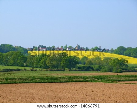 A countryside view of a quintessential English village - stock photo