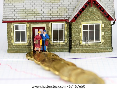 A couple about to walk the path of debt, showing gold coins leading away from their house, asking the question how much debt can  the average couple cope with financially! - stock photo