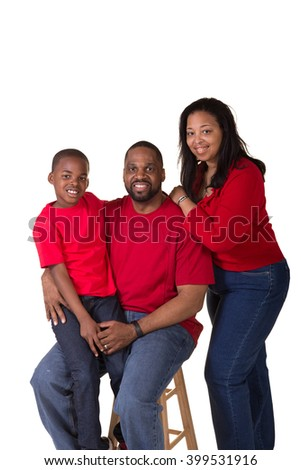 A couple and their school aged son - stock photo