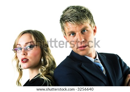 A couple, both business people, looking at the viewer - stock photo