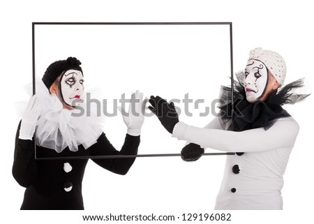 a couple clowns cleaning an empty picture - stock photo