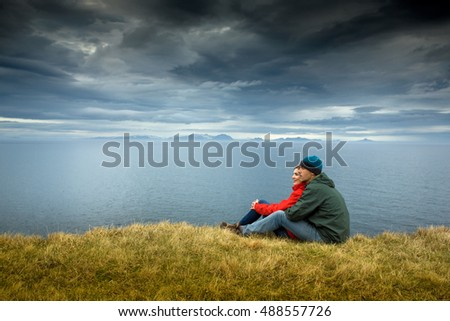 A couple contemplating the beautiful landscape