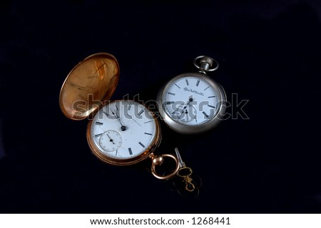 a couple gold and silver vintage pocketwatches