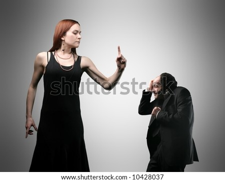 a couple having an angry confrontation - stock photo