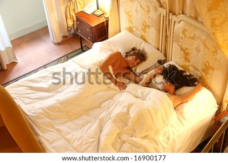 a couple in a bed - stock photo