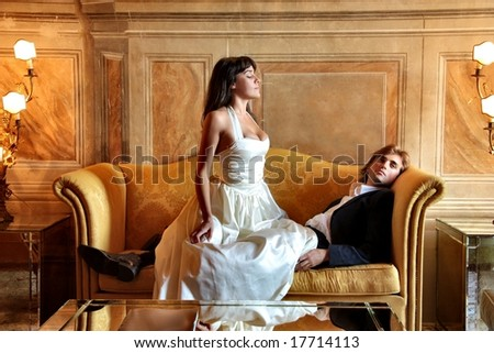 a couple in a luxury sitting room - stock photo