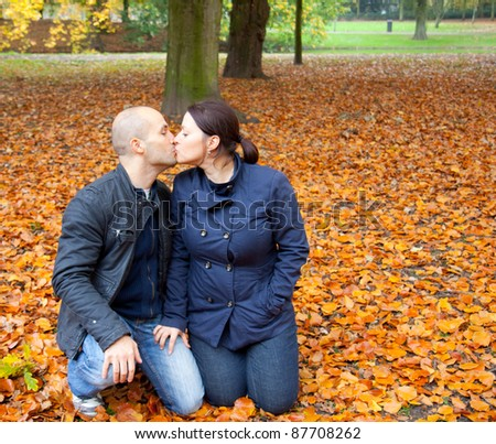 A couple in the autumn is happy - stock photo
