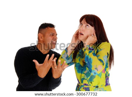 A couple in there forties fighting and arguing, she closed her ear's an he