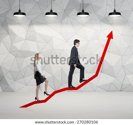 A couple is going up. A concept of the successful business team is making efforts at the career stairs. - stock photo