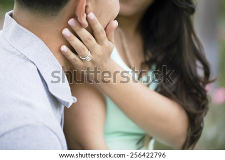 A couple is newly engaged. - stock photo