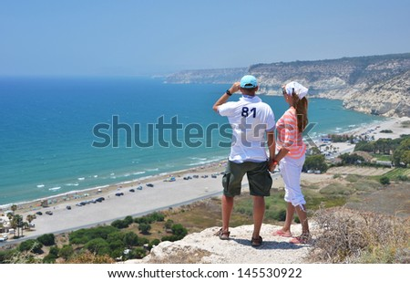 A couple looking to the coastline of Cyprus - stock photo